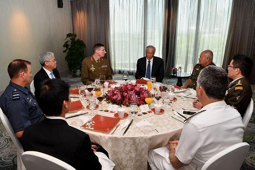 Minister for Defence Ng Eng Hen hosting a lunch for the defence chiefs of the Five Power Defence Arrangements (FPDA) member-nations yesterday. The military chiefs of Singapore, Malaysia, Australia, New Zealand and Britain were attending an FPDA confe