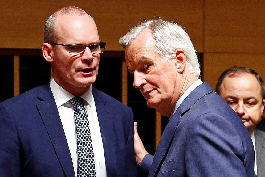 Irish Foreign Minister Simon Coveney (left) with the European Union's chief Brexit negotiator Michel Barnier in Luxembourg yesterday. Britain's proposals are shrouded in secrecy but the focus is on Northern Ireland's relationship to the EU's Customs