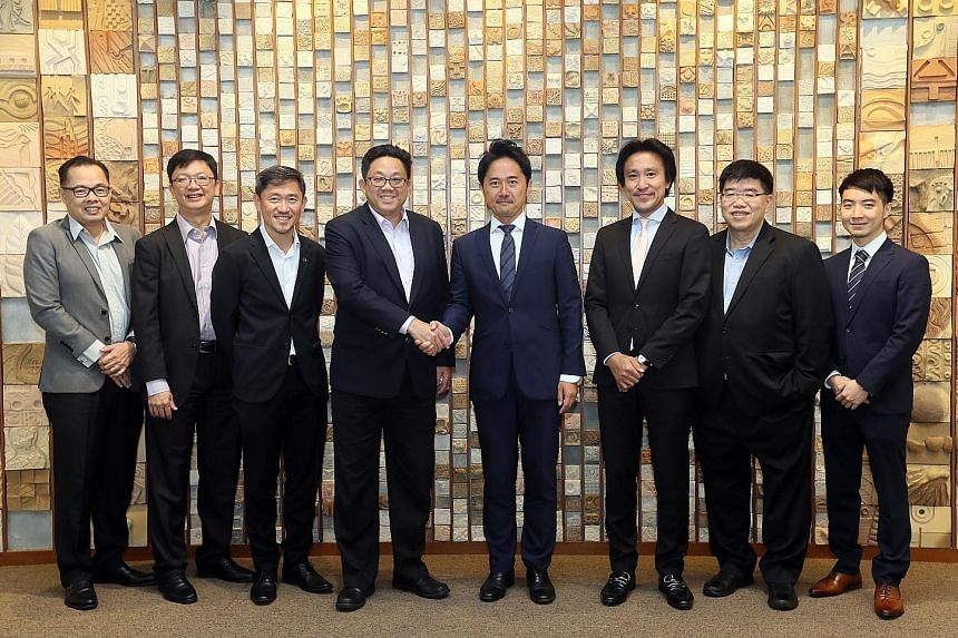 From left: SPH's chief financial officer Chua Hwee Song, head of capital markets Loh Yew Seng, deputy chief executive Anthony Tan, and chief executive Ng Yat Chung with Bridge C Capital's CEO Daizo Yokota, and Singapore-based chairman Aki Tokuyama, S