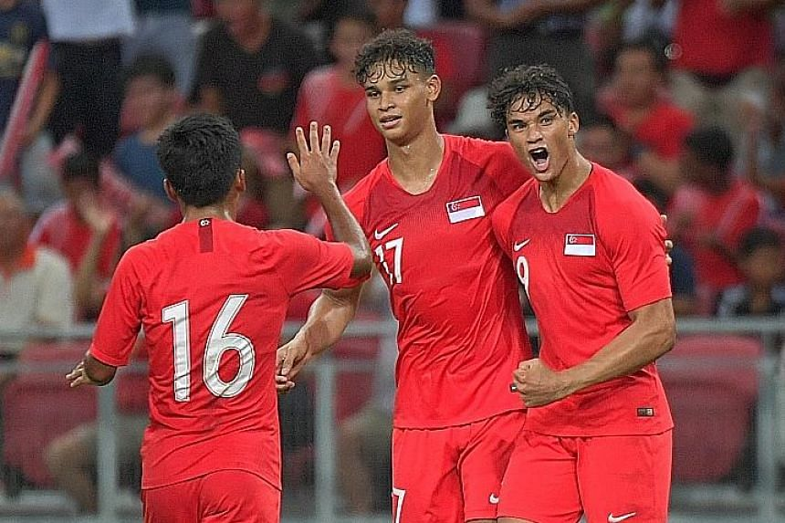 Left: Uzbekistan's Eldor Shomurodov, their two-goal hero, missing an open goal after rounding Singapore goalkeeper Izwan Mahbud in the second half of their World Cup Asian Zone Group D qualifier. Singapore had gone into the break with the game poised