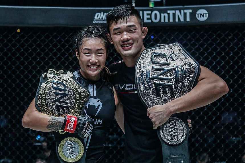 Angela Lee and her brother Christian posing with their belts after both won their bouts at the One: Century event in Tokyo on Sunday. Angela is ranked 14th on ESPN's top 25 MMA fighters under 25 list, while Christian is 22nd. PHOTO: ONE CHAMPIONSHIP
