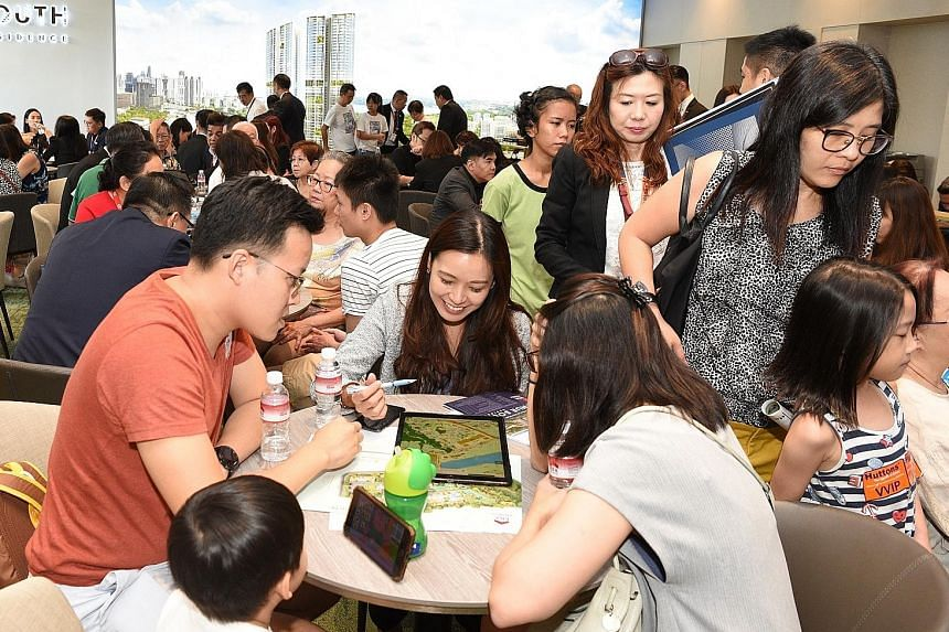 The crowd at the preview of Avenue South Residence, which was launched last month. The condominium in the city fringe made top seller last month, with 361 units moved at a median price of $1,941 per sq ft. PHOTO: UOL GROUP