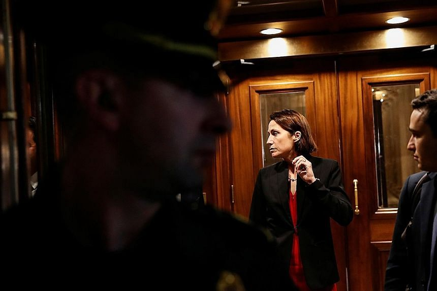 Ms Fiona Hill (above), former senior director for Russian and Eurasian affairs, leaving after testifying in the impeachment inquiry into US President Donald Trump in Washington on Monday. She said then national security adviser John Bolton (below) in