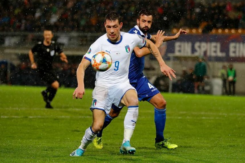 Italy's forward Andrea Belotti (left) vies with Liechtenstein's defender Daniel Kaufmann during the Euro 2020 Group J qualification football match between Liechtenstein and Italy at the Rheinpark Stadium in Vaduz, on Oct 15, 2019.