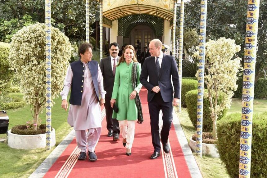 Pakistan's Prime Minister Imran Khan (left) walks with Britain's Prince William, Duke of Cambridge, and his wife Catherine, Duchess of Cambridge, at the Prime Minister House in Islamabad on Oct 15, 2019.