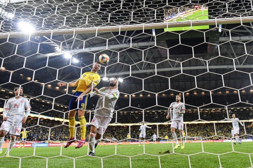Sweden's Marcus Berg (second from left) scores during the Uefa Euro 2020 Group F qualifying soccer match between Sweden and Spain at Friens Arena in Solna, Stockholm, Sweden, Oct 15, 2019.