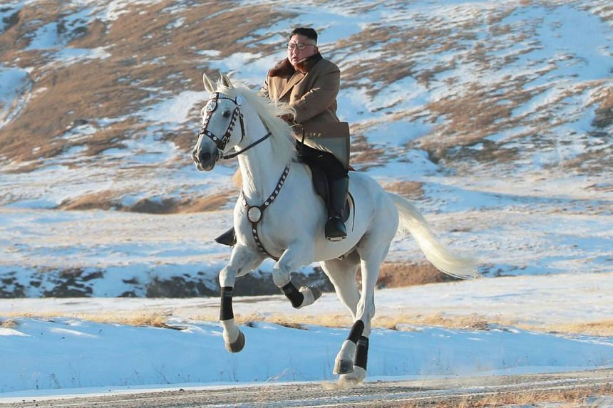 North Korean leader Kim Jong Un riding alone on a large white horse through snowy fields and woods on Mount Paektu, the spiritual homeland of the Kim dynasty.