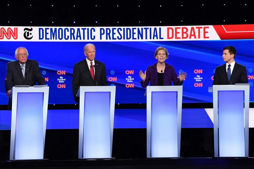 Democratic presidential hopefuls (from left) Bernie Sanders, Joe Biden, Elizabeth Warren and Pete Buttigieg at the fourth Democratic primary debate of the 2020 presidential campaign season at Otterbein University in Ohio on Oct 15.