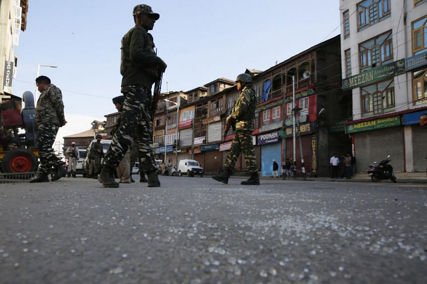 Indian paramilitary soldiers stand guard near the site of a grenade attack in Srinagar, on Oct 12, 2019.