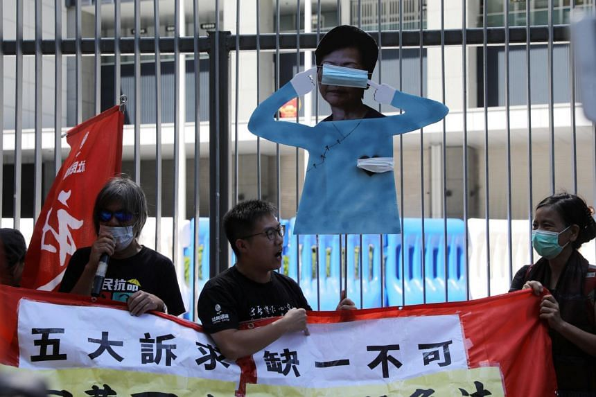 A cutout of Chief Executive Carrie Lam is seen on a fence as protesters gather ahead of an annual policy address, after four months of anti-government protests, at the Legislative Council in Hong Kong on Oct 16, 2019.