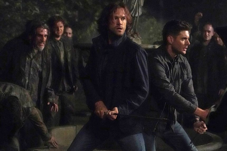 Supernatural stars Jared Padalecki (centre) and Jensen Ackles (right), who play vigilante brothers who hunt ghosts, demons, vampires and other monsters.