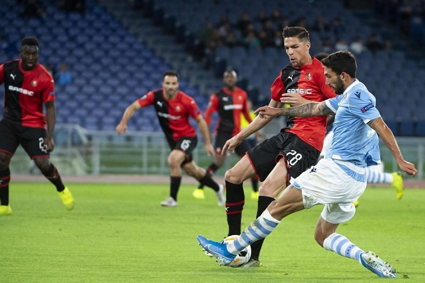 Lazio's Danilo Cataldi (in blue) in action during a match against French club Rennes on Oct 3, 2019. Lazio was charged after some of their supporters made fascist salutes in the Curva Nord section during the match.