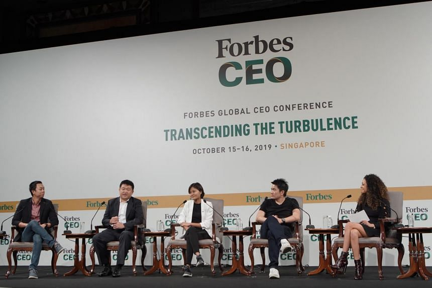 (From left) Klook co-founder and chief operating officer Eric Gnock Fah, Sea chairman and group chief executive officer Forrest Li, Grab co-founder Tan Hooi Ling and Razer co-founder and chief executive Tan Min-Liang at a panel at the Forbes Global C