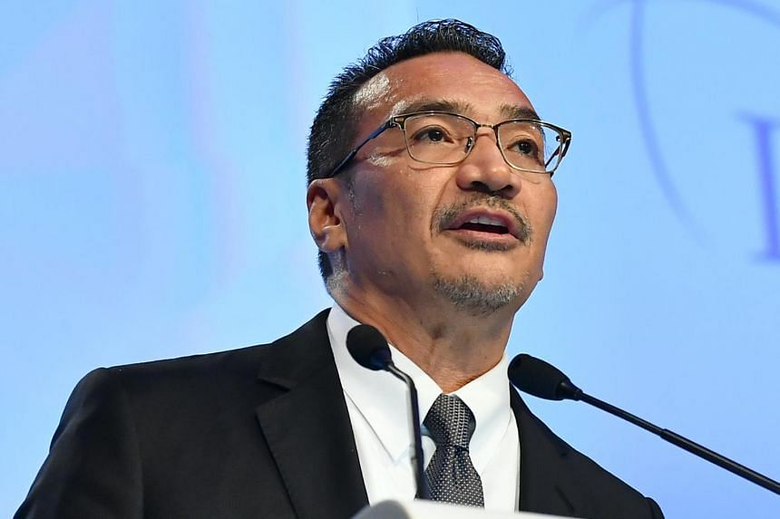 In this picture taken on June 3, 2019, former Malaysian Umno vice-president Hishammuddin Hussein is seen speaking at an event in Singapore. The ruling  Pakatan Harapan coalition issued an unusual joint statement naming him as a leader trying to break
