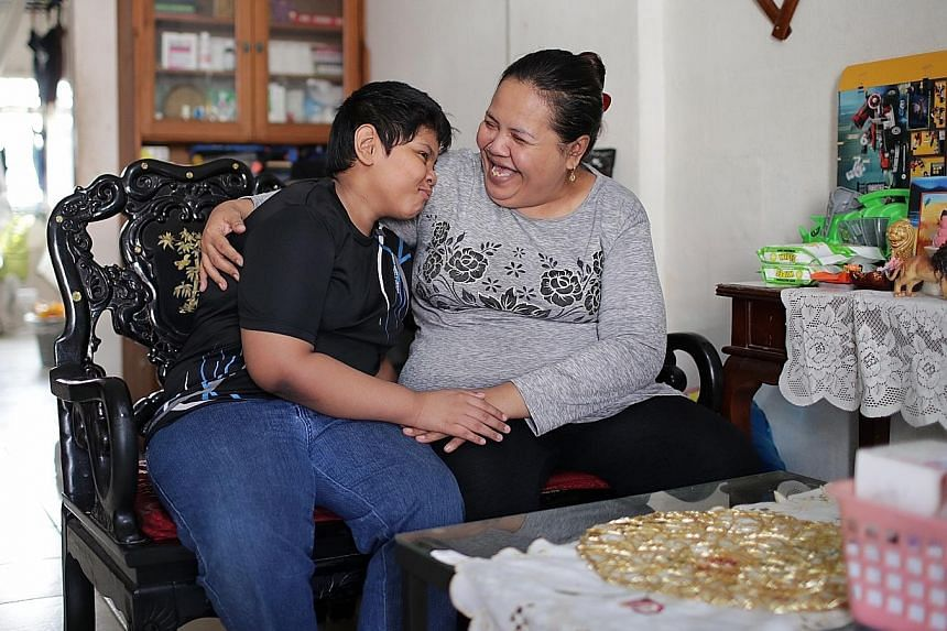 Madam Maniseh Mustapah with her son Muhammad Rasul Osman Ghani in their rental flat. Madam Maniseh, who used to be a cleaner, had to stop working due to health problems and depends on the $850 a month that her family gets from the ComCare Short-to-Me