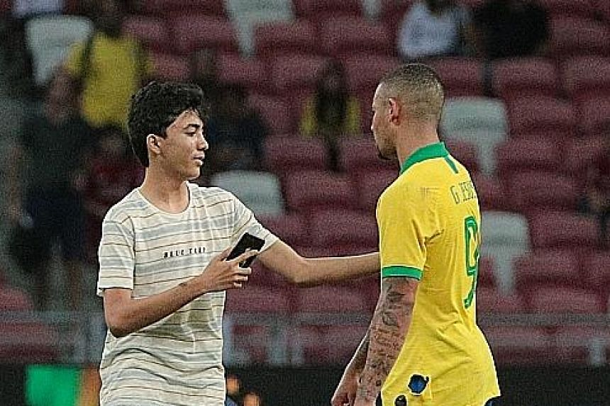 A young pitch invader running onto the field at the National Stadium after the friendly match between Brazil and Senegal last Thursday. Another pitch invader was seen approaching Brazil forward Gabriel Jesus at the same match. They were both apprehen