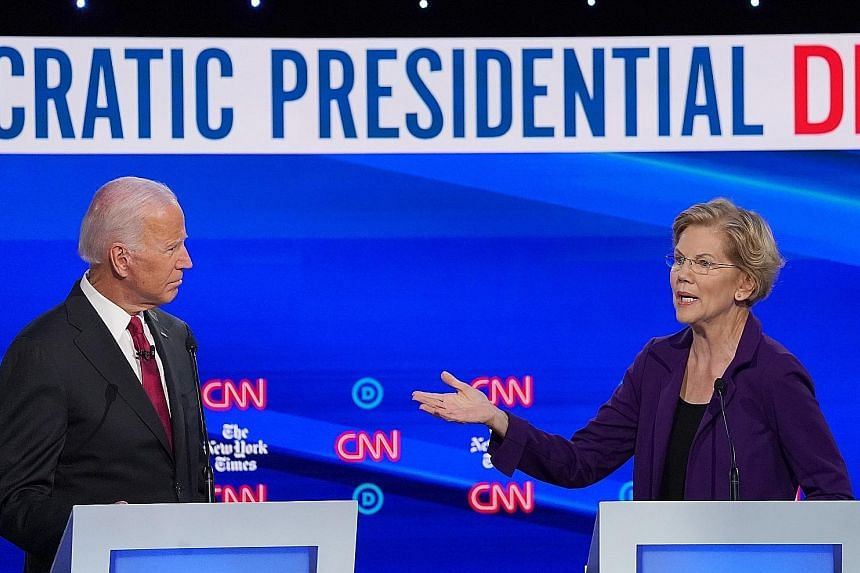 US Senator Elizabeth Warren and former vice-president Joe Biden at the fourth debate of the Democratic presidential candidates in Westerville, Ohio, on Tuesday.