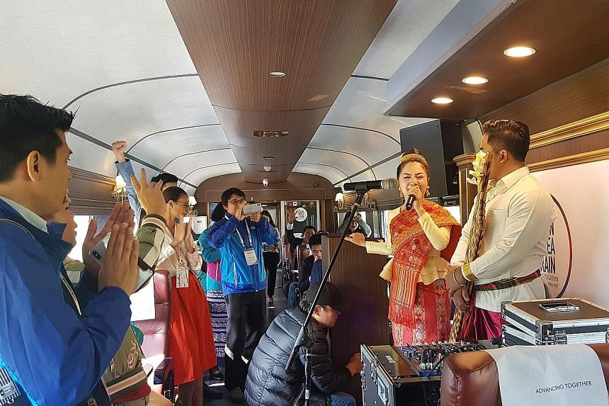 Participants on board the Asean-Korea Train watching a performance yesterday. Some 200 delegates from 10 Asean member states and South Korea took the one-time train travelling towards the southern port city of Busan in the lead up to the Asean-Korea