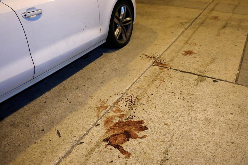 Bloodstains are seen on the sidewalk at the site where the leader of Hong Kong's Civil Human Rights Front Jimmy Sham was attacked in Mong Kok district in Hong Kong, on Oct 16, 2019.