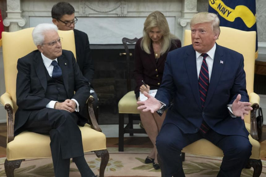 US President Donald Trump (right) speaks during a meeting with Italian President Sergio Mattarella in the Oval Office of the White House in Washington, DC on Oct 16, 2019.