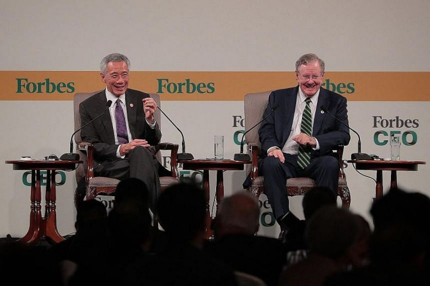 Prime Minister Lee Hsien Loong (left) in a dialogue with Mr Steve Forbes, chairman and editor-in-chief of Forbes Media, at the Forbes Global CEO Conference yesterday, Oct 16, 2019.