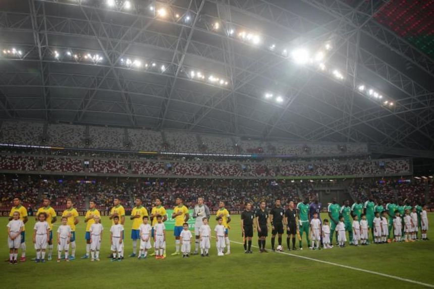 Teams line up as Brazil take on Senegal in their international friendly football match at the National Stadium in Singapore, on Oct 10, 2019.