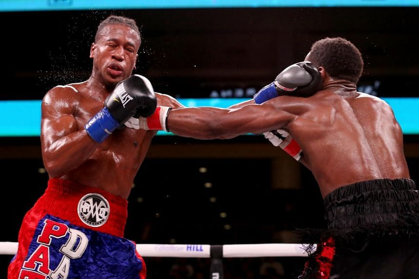 In this photo taken on Oct 12, 2019, Patrick Day (left) and Charles Conwell exchange punches in the seventh round of their Super-Weltereight bout at Wintrust Arena in Chicago, Illinois. An unconscious Day had to be stretchered out of the ring followi