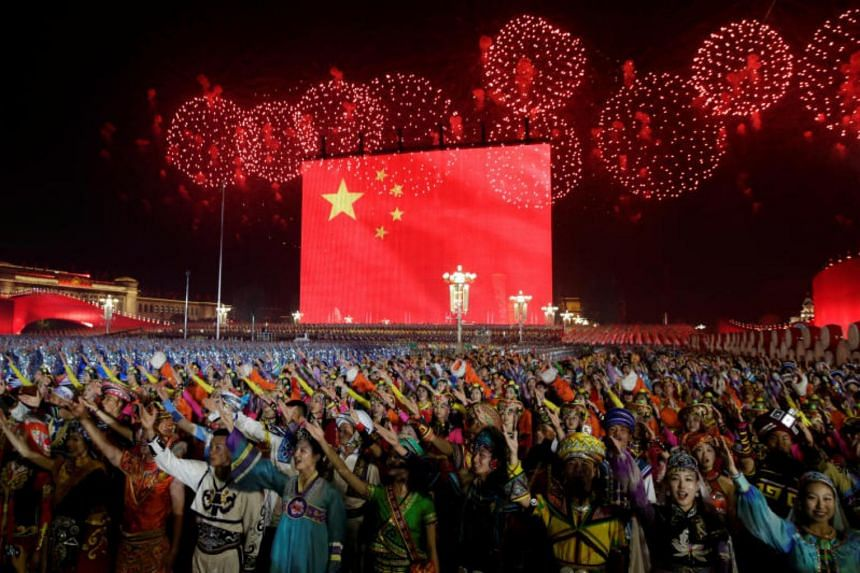 Fireworks explode over Tiananmen Square during celebrations to mark the 70th founding anniversary of People's Republic of China, on Oct 1, 2019.