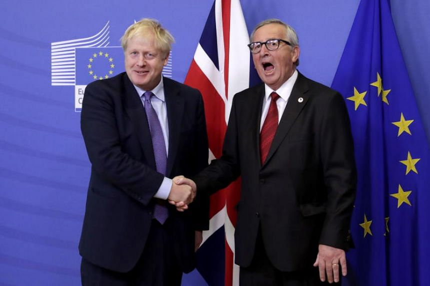 British Prime Minister Boris Johnson (left) with President of the European Commission Jean-Claude Juncker during a press conference on the Brexit deal in Brussels on Oct 17, 2019.