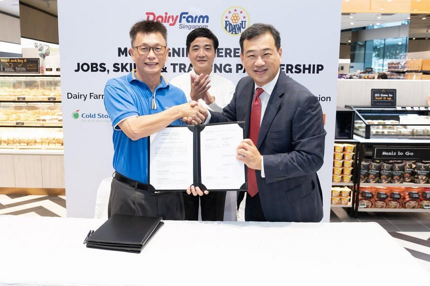 (From left) Food, Drinks and Allied Workers Union general secretary Tan Hock Soon, NTUC Deputy secretary-general Heng Chee How and Dairy Farm Singapore South-east Asia chief executive Sam Kim at the signing of the partnership agreement on Oct 17, 201