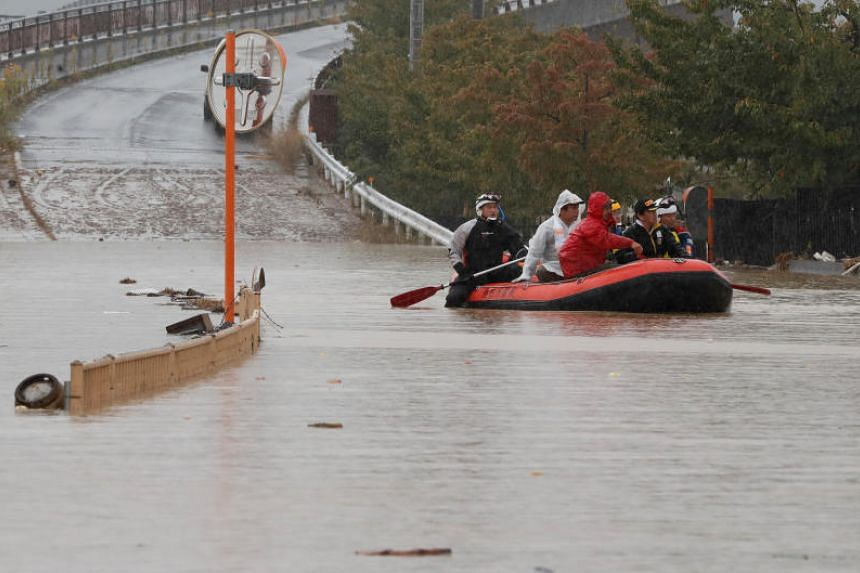 People flee in a boat in the aftermath of Typhoon Hagibis in Nagano, Japan, on Oct 14, 2019. It is one of the worst typhoons to hit Japan in about 60 years.