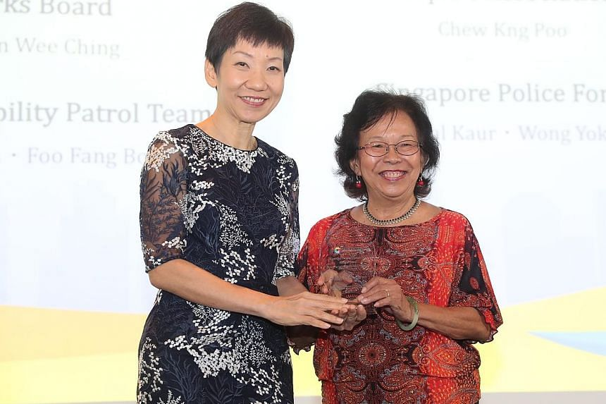Ms Eileen Chan, chairman of the Nee Soon Central Active Mobility Patrol team, receiving an award in the community category on behalf of her team from Minister for Culture, Community and Youth Grace Fu at the Municipal Services Awards event yesterday.