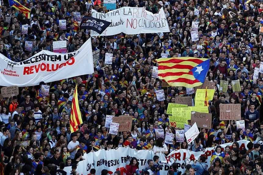 A protest in Barcelona yesterday. Violence in Catalonia erupted on Monday, after Spain's Supreme Court handed down long prison terms to nine Catalan leaders for their role in the failed independence bid in 2017.