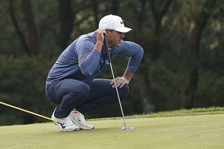 Brooks Koepka lining up his shot during the first round of the CJ Cup at the Nine Bridges Golf Club in Jeju. The world No. 1 is tied for 15th after a mixed round. PHOTO: EPA-EFE