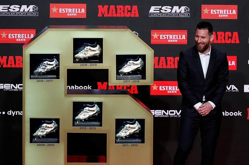 Barcelona's proud captain Lionel Messi showing off his six Golden Shoe prizes, one each for scoring the most goals in a European domestic league season. PHOTO: REUTERS