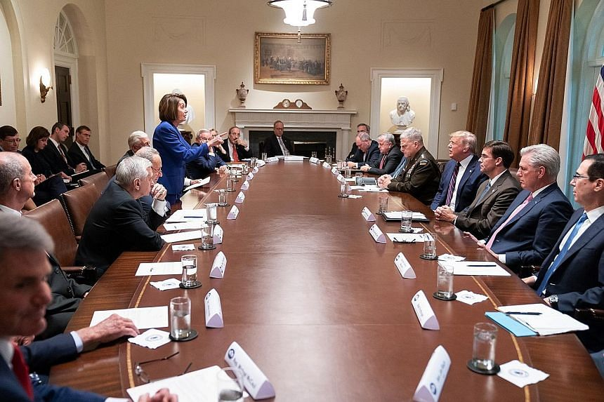 House Speaker Nancy Pelosi facing off against President Donald Trump on Wednesday, before cutting short the meeting on the situation in Syria following Mr Trump's decision to pull US forces out of the country. PHOTO: THE WHITE HOUSE/TWITTER