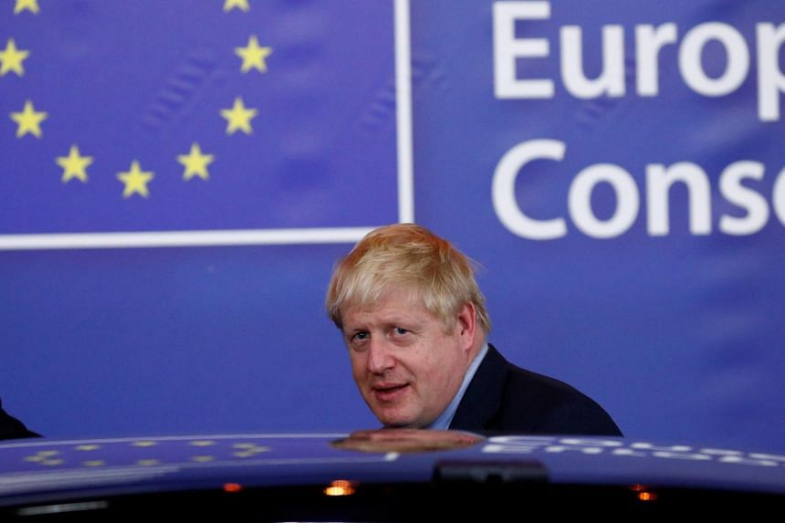 Britain's Prime Minister Boris Johnson leaves the European Council after the Brexit-dominated European Union leaders summit in Brussels, Belgium on Oct 18, 2019.