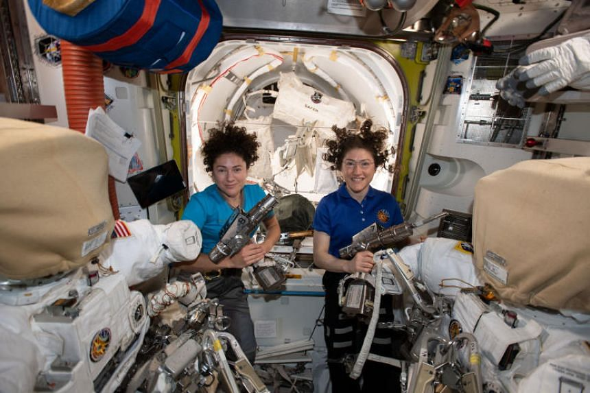 US astronauts Christina Koch (right) and Jessica Meir stepped outside the International Space Station on the first all-female spacewalk on Oct 18, 2019.