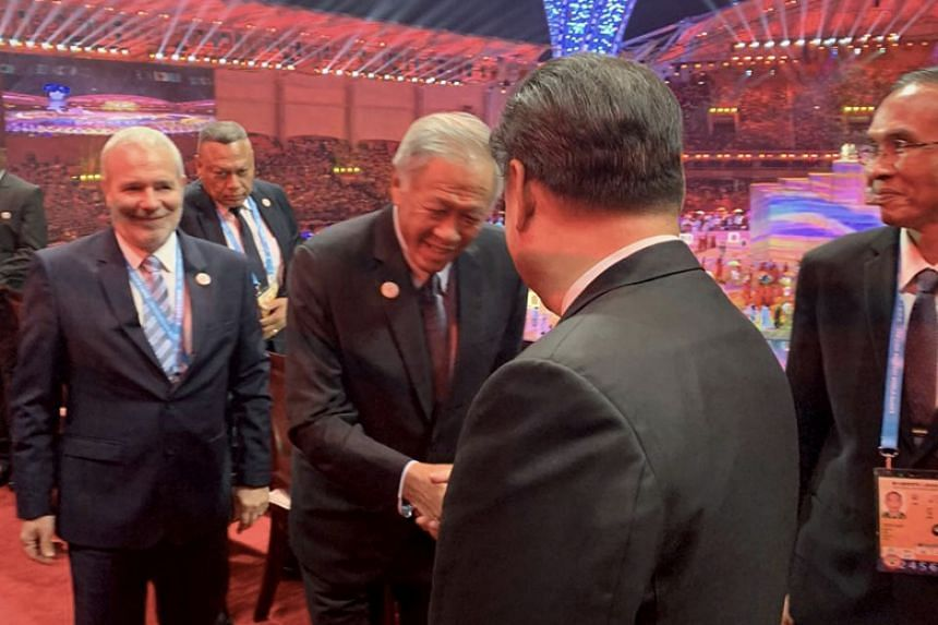 Defence Minister Ng Eng Hen meeting Chinese President Xi Jinping at the opening ceremony of the 7th Military World Games in Wuhan, China, on Oct 18, 2019.