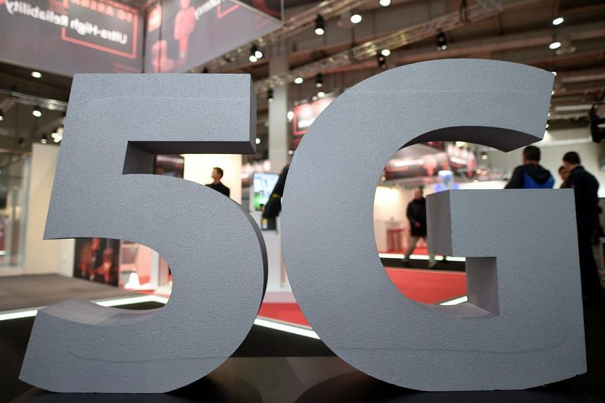 A photo taken Oct 10, 2019, showing a logo of the upcoming mobile standard 5G in Germany. Users of 5G handsets moving out of a 5G coverage area will not experience surfing disruption as they will automatically be connected to a 4G connection with the