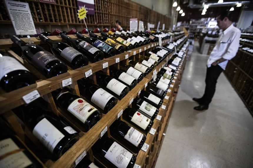 A customer shops for French wine in a shop in Los Angeles, California, on Oct 4, 2019.