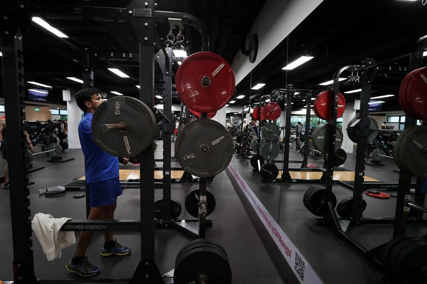 A man lifts weights at a gym in Punggol Safra on Sept 2, 2018.