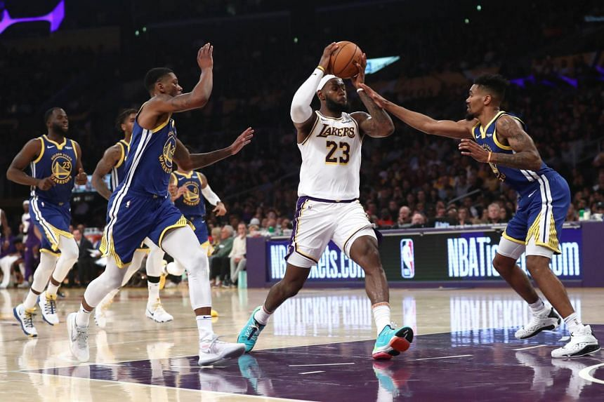 LeBron James dribbles through the defense of Draymond Green, Alfonzo McKinnie and Jacob Evans during the second half of a game at Staples Center, on Oct 16, 2019 in Los Angeles, California.
