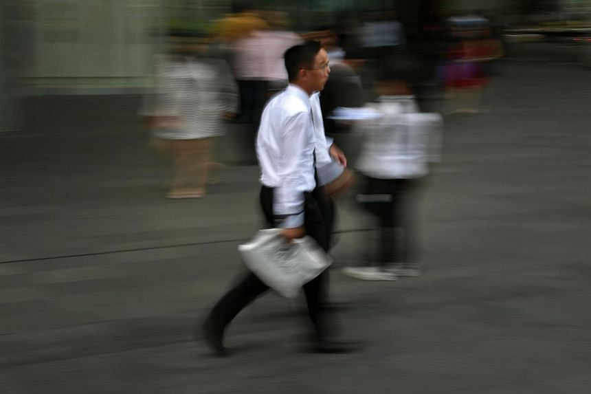Office workers in Singapore's financial district on Feb 14, 2018.
