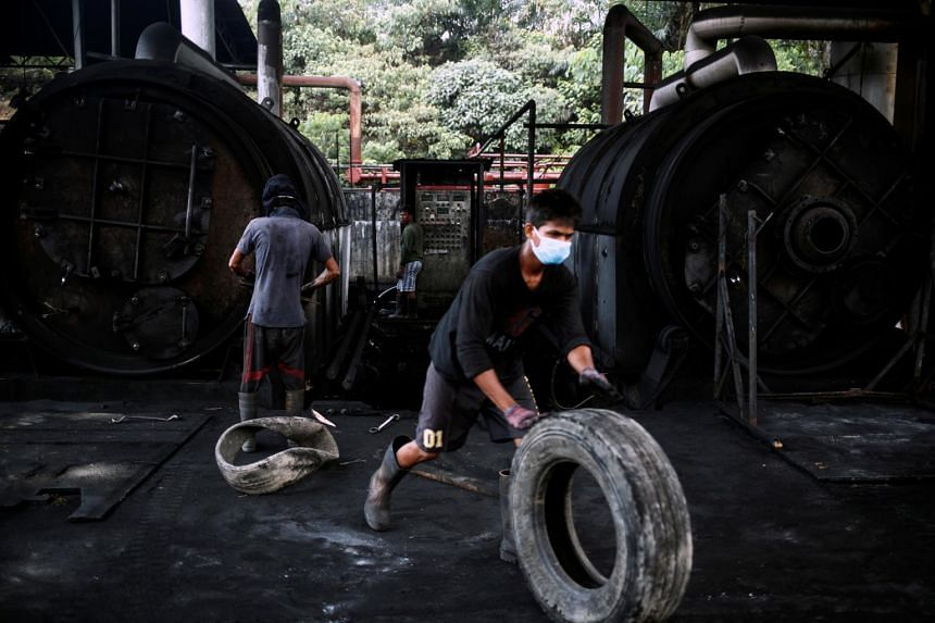 Workers at a tyre pyrolysis plant in Johor, Malaysia, on Aug 7, 2019.