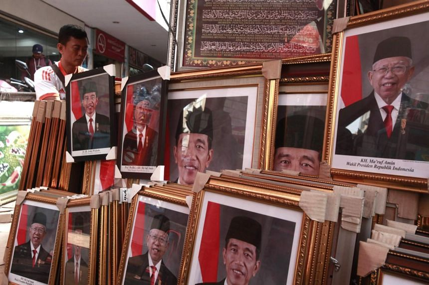 Official portraits of Indonesia's President Joko Widodo and Vice-President Ma'ruf Amin.