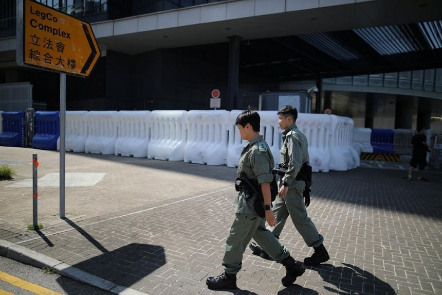 Hong Kong police officers patrol outside the Legislative Council Complex in Hong Kong on Oct 15, 2019. A Hong Kong court granted an injunction earlier this week to ban anyone from blocking or damaging areas used to house married police officers.