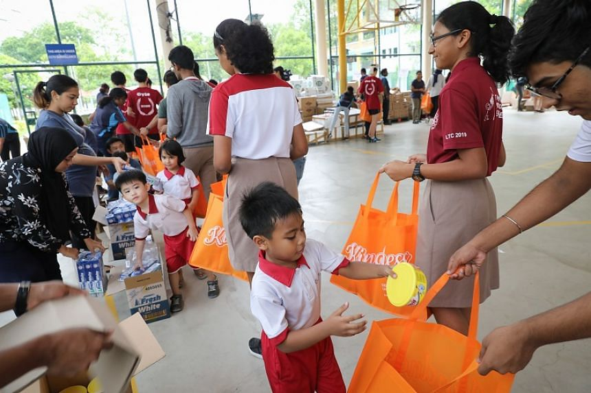 Six-year-old Abdul Atif from Cherry Kidz Montessori School was one of the youngest of 700 volunteers who prepared gift packs for beneficiaries on Oct 18, 2019.