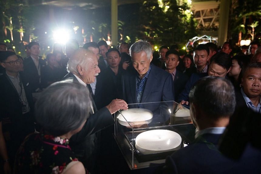 Prime Minister Lee Hsien Loong and architect Moshe Safdie looking at a model of Jewel during the official opening of Jewel Changi Airport on Oct 18, 2019.
