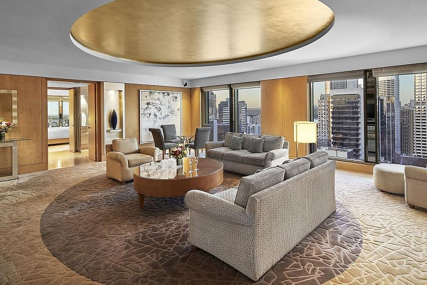 Sleek designs and luxurious suites (above) are part of The Fullerton Hotel Sydney, which also has a grand staircase.